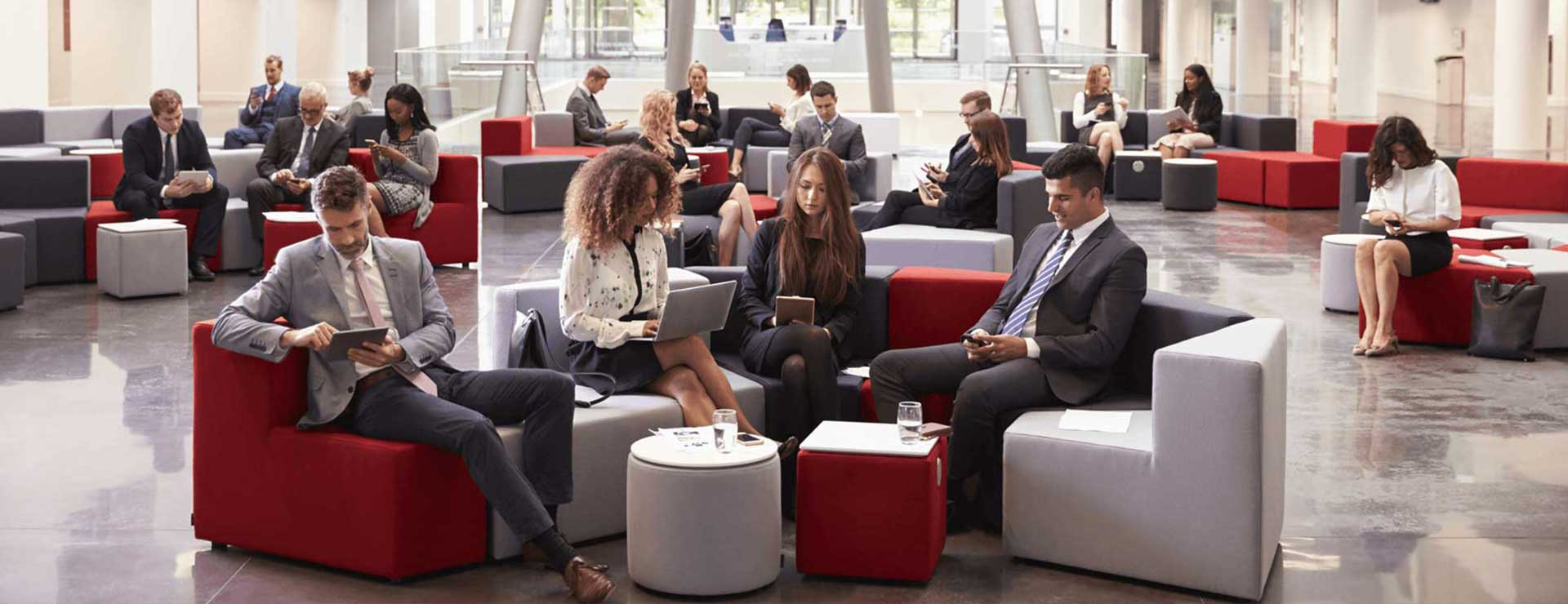 Business people sitting in a modern looking lobby